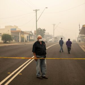 NO ARCHIVINGMandatory Credit: Photo by SEAN DAVEY/EPA-EFE/Shutterstock (10515906j)A Cobargo resident looks at destroyed buildings in Cobargo, New South Wales, Australia, 01 January 2020.Bushfires in Australia, Cobargo - 01 Jan 2020