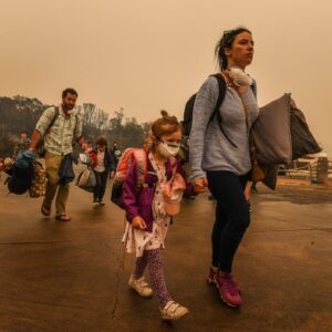 MALLACOOTA, AUSTRALIA - JANUARY 02: (AUSTRALIA OUT): People stranded in Mallacoota, Victoria are evacuated by army personnel to the HMAS Choules after bushfires ravaged the town on December 30th on January 3, 2020 in Mallacoota, Victoria, Australia. (Photo by Justin McManus/The Age/Fairfax Media via Getty Images)