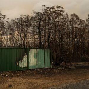 A fence burnt by bushfire in Lake Conjola in NSW, Australia on Jan. 5, 2020. The community of Lake Conjola was devastated by bushfire on Dec. 31. According to the NSW Rural Fire Service 150 fires burnt throughout NSW on Sunday, with many uncontained. Since the fire season started there have been 23 deaths, more than 1,300 homes destroyed, countless animals killed and tens of thousands of acres of national park and forest land burned. Photo by Adam Ferguson